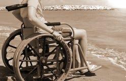 Menino na cadeira de rodas com efeito tonificado sepia do vintage foto de stock royalty free