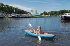 Menino na canoa Imagem de Stock Royalty Free