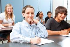 Menino na classe de escola secundária Imagem de Stock