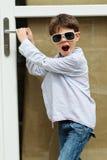 Menino na frente da porta Foto de Stock Royalty Free