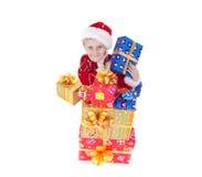 Menino na roupa do Natal com brinquedos Imagens de Stock