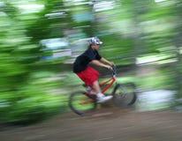 Menino na velocidade da bicicleta Foto de Stock Royalty Free