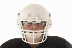 Menino no capacete de futebol americano Fotografia de Stock Royalty Free