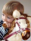 Menino no cavalo de balanço Imagens de Stock