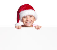 Menino no chapéu de Santa com placa Fotografia de Stock
