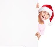 Menino no chapéu de Santa com placa branca Imagens de Stock