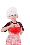 Menino no chapéu do cozinheiro chefe Fotografia de Stock Royalty Free