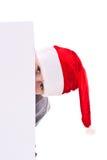 Menino no chapéu do Natal com uma placa Imagens de Stock
