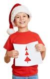 Menino no chapéu vermelho com letra a Santa - conceito do Natal do feriado de inverno Fotos de Stock Royalty Free