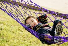Menino no hammock Imagens de Stock