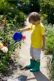 Menino no jardim Foto de Stock Royalty Free