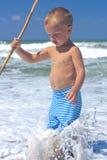 Menino no mar. Fotos de Stock Royalty Free