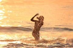 Menino no mar Fotografia de Stock Royalty Free