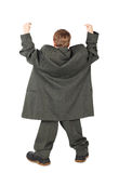 Menino no terno do homem grande e carregadores da parte traseira Imagem de Stock
