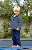 Menino no trampoline Foto de Stock Royalty Free