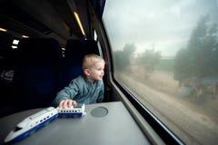 Menino no trem Foto de Stock