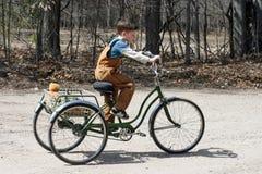 Menino no triciclo Fotografia de Stock