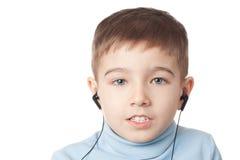 Menino nos fones de ouvido Imagem de Stock Royalty Free