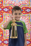 Menino novo adorável com Ramadan Lantern Looking Away Fotografia de Stock Royalty Free
