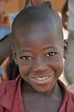 Menino novo africano feliz fotografia de stock