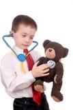 Menino novo atrativo considerável vestido como um doutor Fotos de Stock Royalty Free