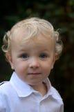 Menino novo com cabelo louro fotografia de stock royalty free