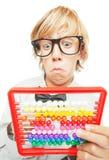 Menino novo com calculadora do ábaco Imagens de Stock