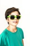 Menino novo com dois óculos de sol Imagem de Stock Royalty Free
