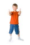 Menino novo com dois polegares acima Fotografia de Stock