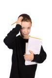 Menino novo com dor de cabeça dos trabalhos de casa Imagens de Stock Royalty Free