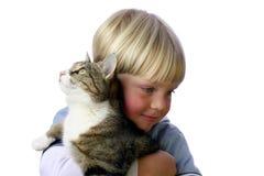 Menino novo com gato Foto de Stock