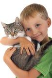 Menino novo com gato Fotos de Stock Royalty Free