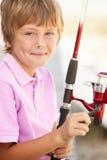 Menino novo com haste de pesca Imagem de Stock Royalty Free