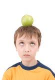 Menino novo com maçã Fotografia de Stock Royalty Free