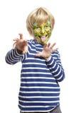 Menino novo com o monstro da pintura da face Imagens de Stock Royalty Free