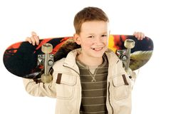 Menino novo com skate Imagem de Stock