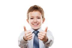 Menino novo de sorriso da criança do homem de negócios que gesticula o polegar acima do sucesso s Fotos de Stock