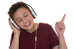 Menino novo do adolescente que escuta a música Imagens de Stock Royalty Free