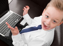 Menino novo do homem de negócios confundido Fotografia de Stock