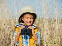 Menino novo do safari Fotografia de Stock Royalty Free