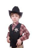 Menino novo do xerife que desgasta um emblema dos marechais Fotografia de Stock Royalty Free