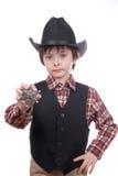 Menino novo do xerife que prende um emblema dos marechais Fotografia de Stock
