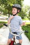 Menino novo em uma bicicleta Foto de Stock Royalty Free