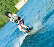 Menino novo em Wakeboard Foto de Stock Royalty Free