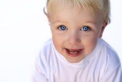 Menino novo feliz no fundo branco fotografia de stock royalty free