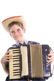 Menino novo feliz que joga um vertical accordian Fotografia de Stock