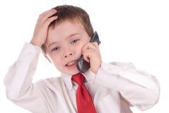 Menino novo irritado do negócio na pilha Fotografia de Stock
