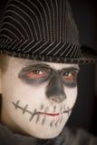 Menino novo na composição do crânio para Dia das Bruxas Imagem de Stock