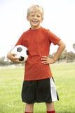 Menino novo na equipa de futebol Imagem de Stock Royalty Free
