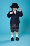 Menino novo na farda da escola fotografia de stock